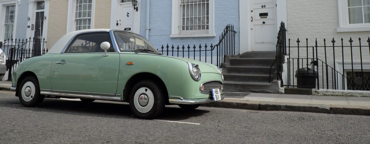 nissan figaro parked on street in uk